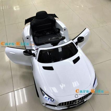 Электромобиль Mercedes-Benz GTR AMG белый (колеса резина, кресло кожа, пульт, музыка)